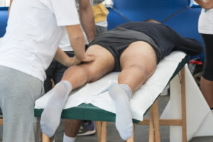 A sports injury can happen to anyone, here you see a sportsman having therapy